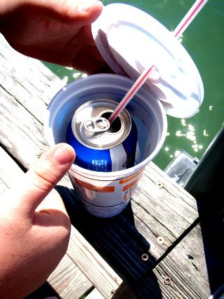 haha! New summer trick for floating the river. :) You get to use your straw without it floating out & if you spill it's ok too! Brilliant!