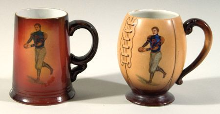 """Pair of University of Pennsylvania football decorative porcelain steins c.1900-1905. Football shaped porcelain stein featuring hand painted Penn football player graphic on the front and school insignia on the reverse. 6"""" tall signed by artist F.Earl Christy: EX/MT-NM and a cylindrical handled mug with similar Penn football decor by Christy marked """"Usona Goodwin"""" underneath. $545"""