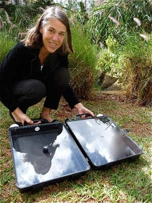 """Petra Wadstrom,a persistent Swedish biochemist, conceived of, refined, & field-tested her Solwatten (Swedish for """"sun water"""") solar water purification unit for over 11 years. It has passed with flying colors, producing 11 liters of clean HOT water, suitable for drinking, cooking, and even washing and laundry. It weighs 2.75 k empty. Maybe it needs wheels? Or backpack handles? It is easy to operate and has an indicator light which turns green when the water is purified. ~ $35. Last 5 years!"""
