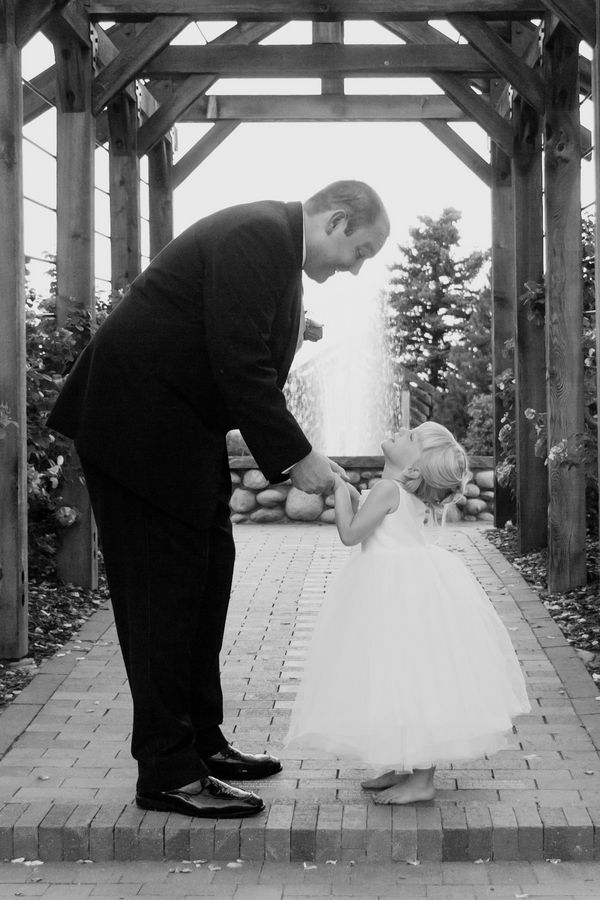 One of the cutest photos ever! | photo by http://www.tinajoinerphotography.com | see more http://www.thebridelink.com/blog/2013/08/26/pink-summer-garden-wedding/