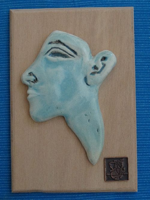 AN EGYPTIAN TURQUOISE CERAMİC FACE INLAY OF AKHENATEN NEW KINGDOM