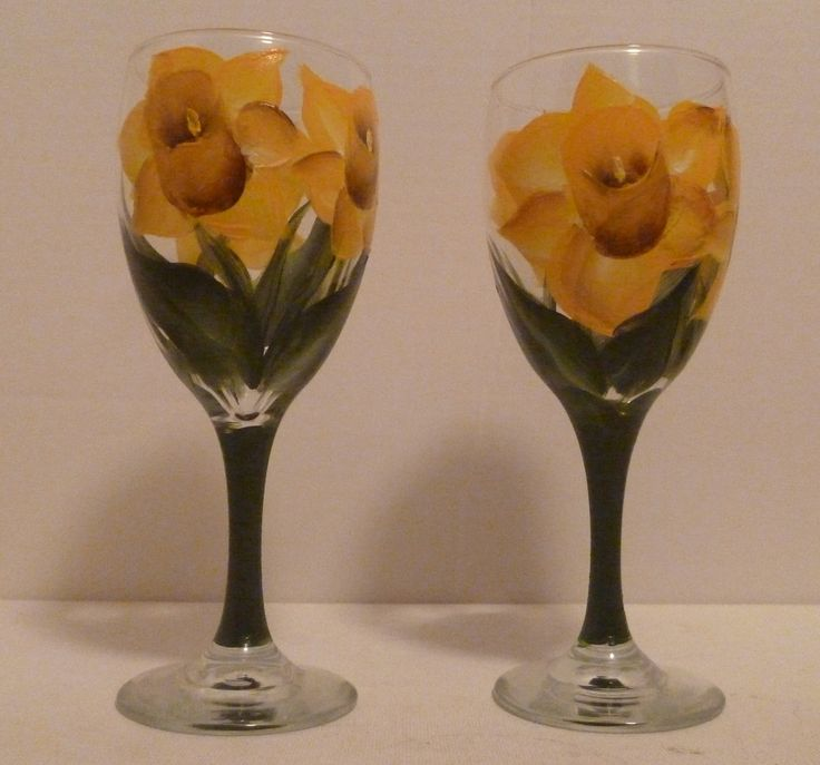 Hand Painted Spring Daffodil Flower Wine Glasses set of 2 by Mary Wilson. Set of 2 hand painted 10.25 oz wine glasses are a fun way to enjoy a nice glass or wine with a friend during the spring season. All of my glassware is hand painted with special glass paint and oven cured for added durability which makes them top shelf dishwasher safe.