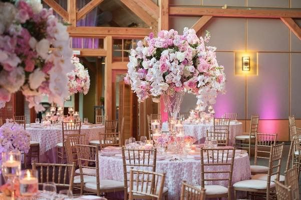 Lovely blush, pink, and white  roses and flowers for a spring wedding! Gold Chiavari chairs add a luxe touch