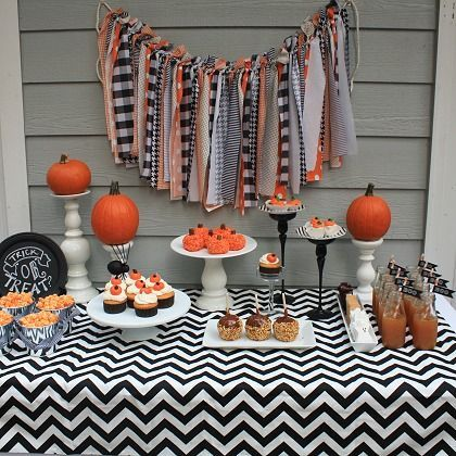 Chevron Dessert Table: This dessert table is done up in classic orange, black, and white -- as seen in the shabby chic garland, chevron table cloth, pumpkin treats, real pumpkins, and more!