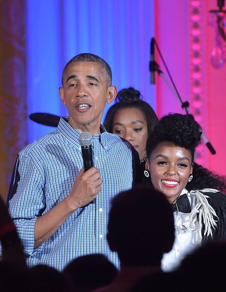 US President Barack Obama speaks beside singer Janelle Monáe (R) during an Independence Day Celebration for military members and administration staff on July 4, 2016 in the East Room of the White House in Washington, DC. / AFP / Mandel NGAN (Photo credit should read MANDEL NGAN/AFP/Getty Images)