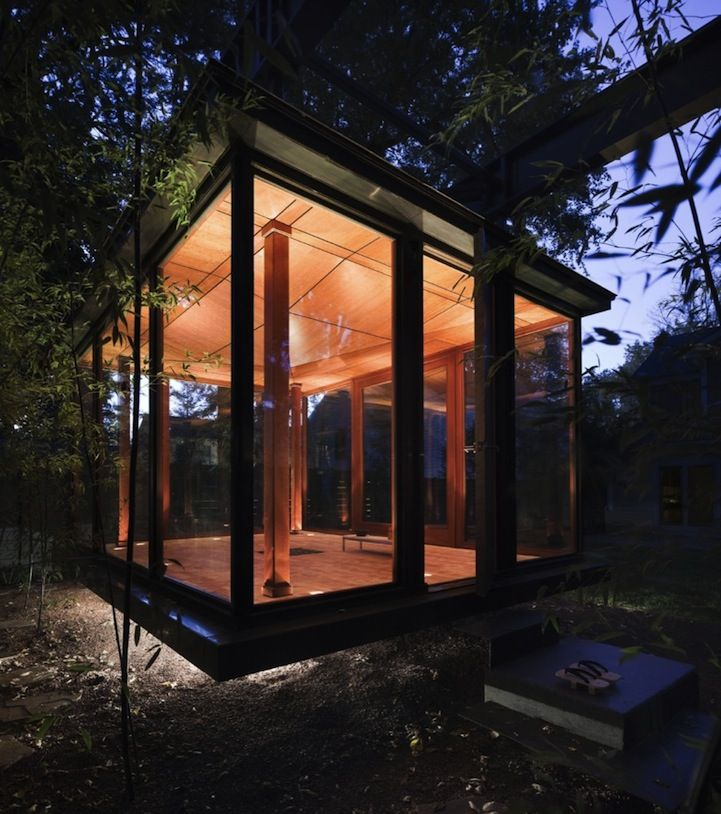 Talk about Feng shui! American architect David Jameson built this amazingly tranquil floating tea house, which also functions as a dining room, meditation area and a stage for the family's musical recitals.  Hanging like a Japanese lantern in the garden of a suburban home northwest of Washington D.C., visitors enter through a 10 cm-thick wooden door, where a faceted timber ceiling points down into the center of the room.  The structure is made of bronze and glass, and is suspended in…
