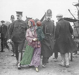 Romani woman being taken away by police. Danish Immigration Museum.: