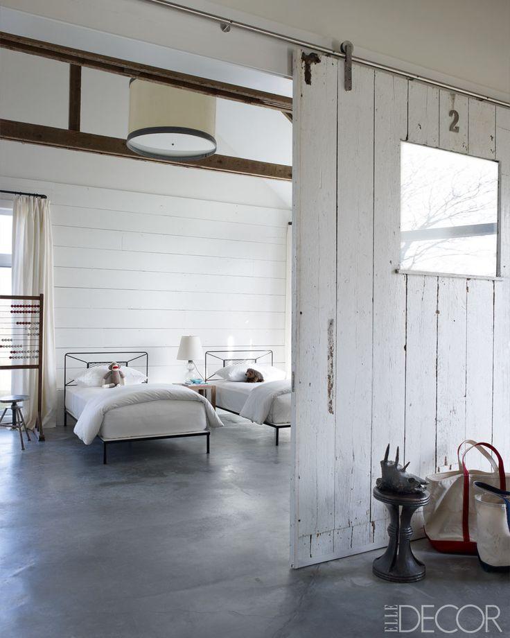 concrete + wood + sliding barn door via Elle Decor