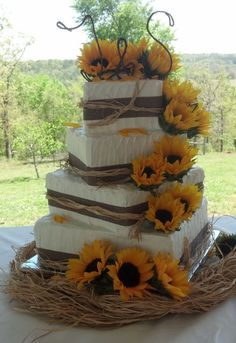 Sunflower Wedding Cake www.tablescapesbydesign.com https://www.facebook.com/pages/Tablescapes-By-Design/129811416695