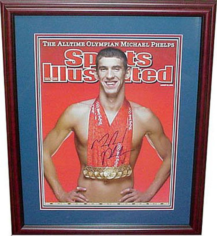 Autographed Michael Phelps Framed Sports Illistrated cover with his 8 gold medals from the 2008 Olympics