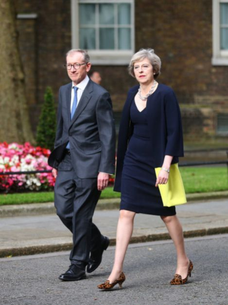 Theresa May's hubby steals the show by pouring his generous curves into a sexy navy suit
