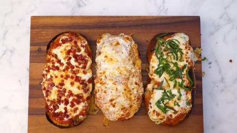 French Bread Pizza 3 Ways | Say hello to your new favorite weeknight pie. We're doing away with the notion that French bread pizza belongs solely in school cafeterias, or the freezer aisle of the grocery store. In fact, it couldn't be easier to make at home—and we bet everyone in the family will go crazy for a slice. We elevated the dish by brushing the bread with a garlicky butter mixture, so you pretty much get garlic brea...