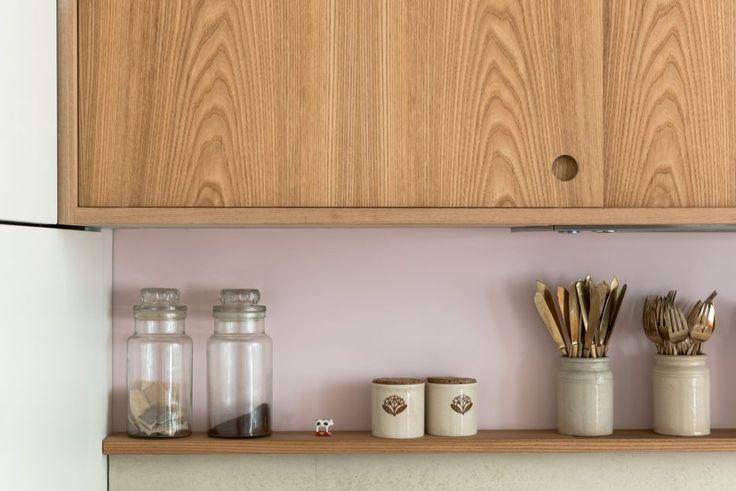 Elm veneer kitchen cabinets. Handle detail.