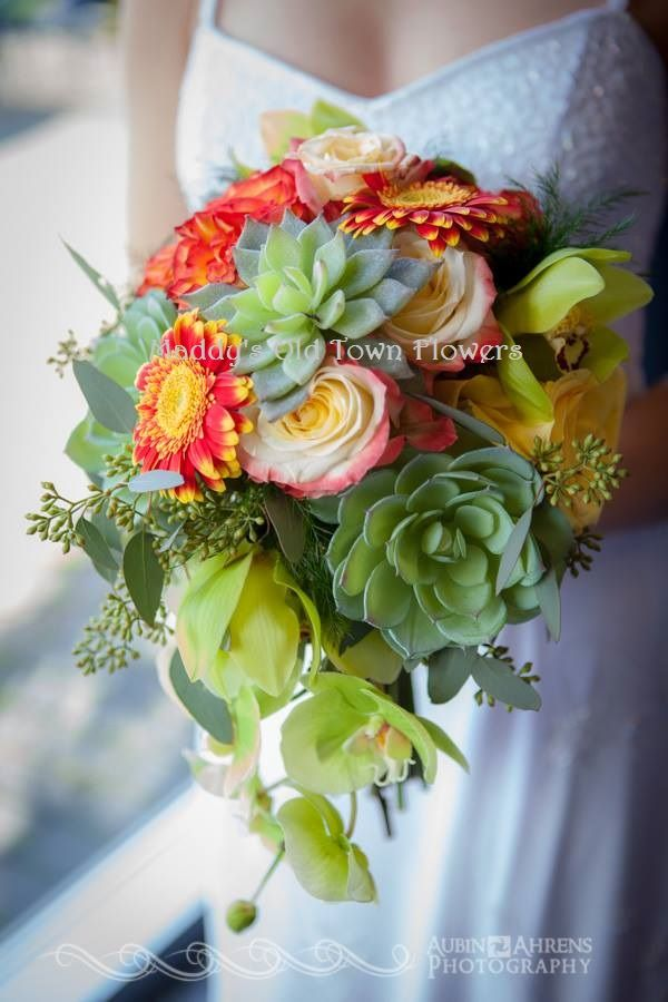 Succulents, Gerbera daisies, cymbidium orchids, seeded eucalyptus, roses
