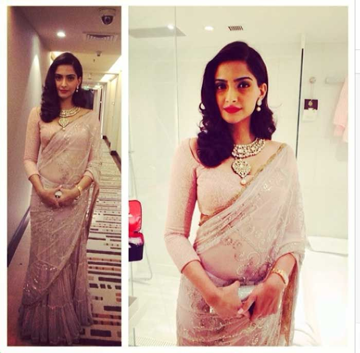 The 'Raanjhanaa' actress was flawless in a lehenga-sari by designer Anamika. Sonam accessorised her look with a heavy polki necklace and top and opted for a vintage hairdo and added colour to her look with the red lips. We like! (Photo: Instagram)