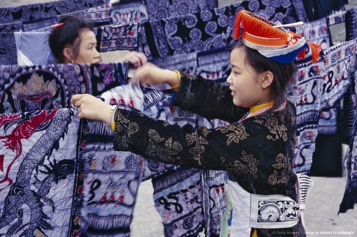 China, Guizhou Province, Gejia Miao woman drying batik fabric