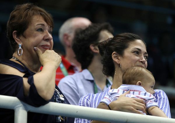 Deborah Phelps Photos Photos - The mother of Michael Phelps of the United States Deborah Phelps, Nicole Johnson and their son Boomer celebrate as the United States Men's 4 x 200m Freestyle team win gold on Day 4 of the Rio 2016 Olympic Games at the Olympic Aquatics Stadium on August 9, 2016 in Rio de Janeiro, Brazil. - Swimming - Olympics: Day 4