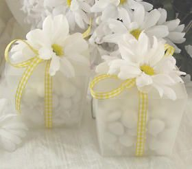 This would be a good idea for favors, but use fake flowers for a cheaper idea. White and yellow flowers.