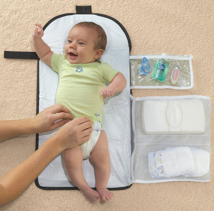 The ChangeAway® portable changing kit is all you need for clean, comfortable diaper changes on the go. Three pockets store essential items, and pad easily folds to fit in virtually any bag or glove co