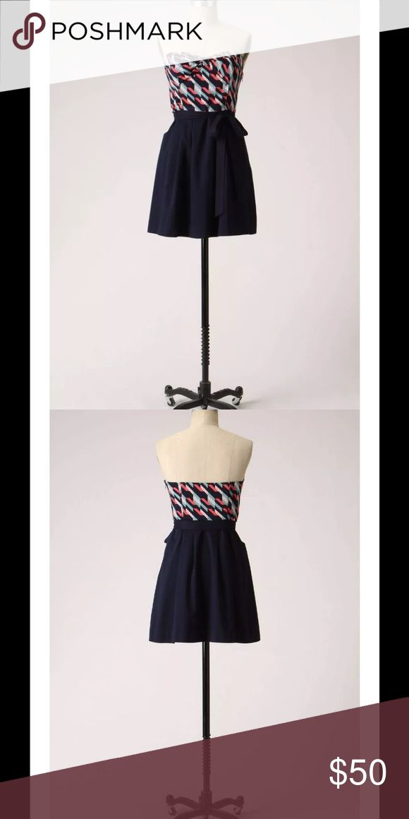 """Anthropologie Signal Flag Dress Navy Strapless $148 Anthropologie Maeve Signal Flag Dress Navy Strapless Sz 4  Maeve's sending a precious message with this frock: its bow-topped bodice brims with a pennant-esque pattern, smartly paired with a navy sateen skirt.  Lightly boned bodice Removable self sash and removable adjustable straps Side zip Cotton; cotton lining 33""""L Imported Style No. 933187 Size: 4 Fabric: 100% Cotton Color: Navy Blue Retail Price: Anthropologie $148 Preowned- Worn only…"""