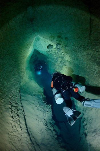 Entering Phantom Cave on an exploration dive in West Texas