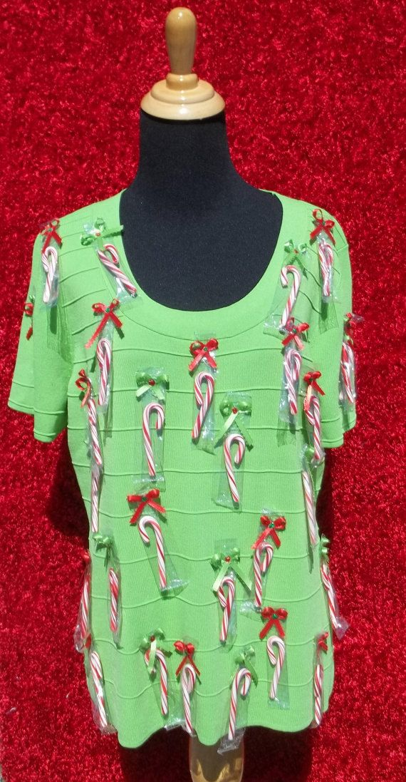 Ugly Sweater with a lot of mini candy canes that can be removed and eaten Bright Green Sweater