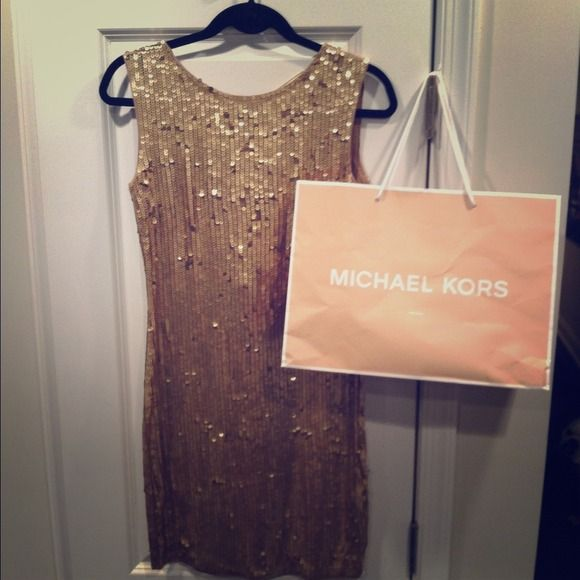 MICHAEL by Michael Kors Dark Camel sequin dress Gorgeous night out dress. Great for NEW YEARS! Called Dark Camel looks true Gold. Gold chain detailing down center of back. Michael Kors printed on chain. Very flattering on most body shapes. Worn here with no bra or slip. MICHAEL Michael Kors Dresses
