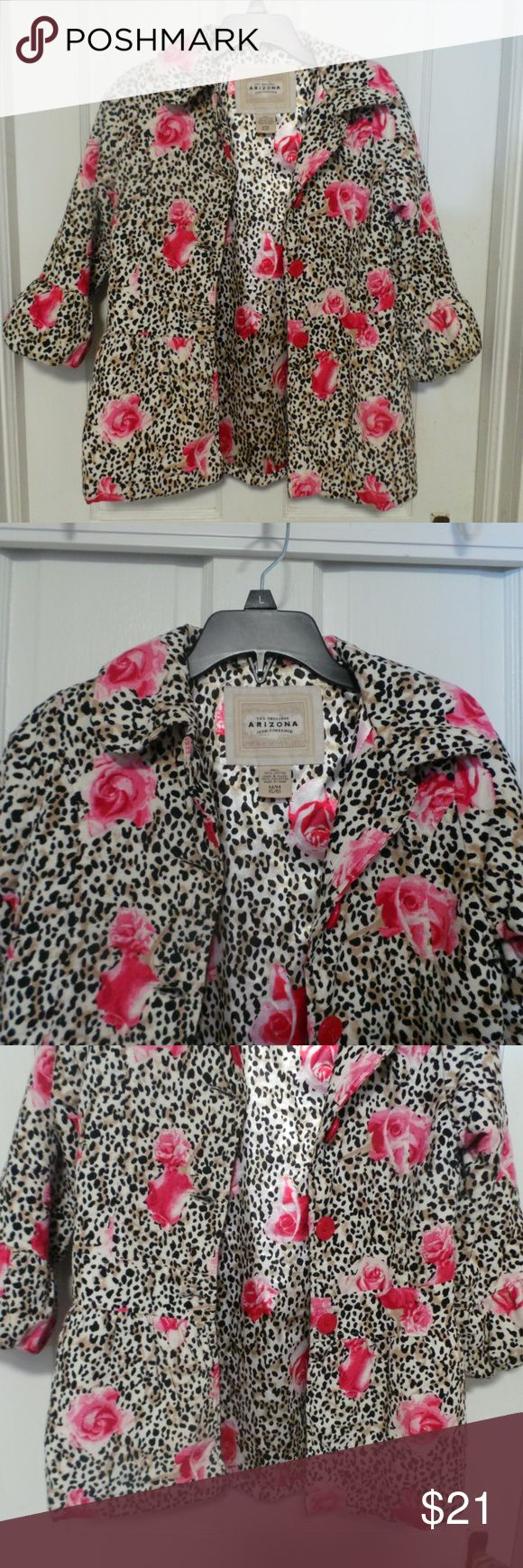 Arizona Girl's Print Coat Girl's size Medium 5-6 Coat. Very pretty and soft material. The outer layer is a soft corduroy material. Fully lined and quilted for warmth. Pattern is an animal print covered in pink roses. Button closure. Sleeves have a wide ruffley band at the wrist. Measures: chest 26, length 23. Arizona Jean Company Jackets & Coats