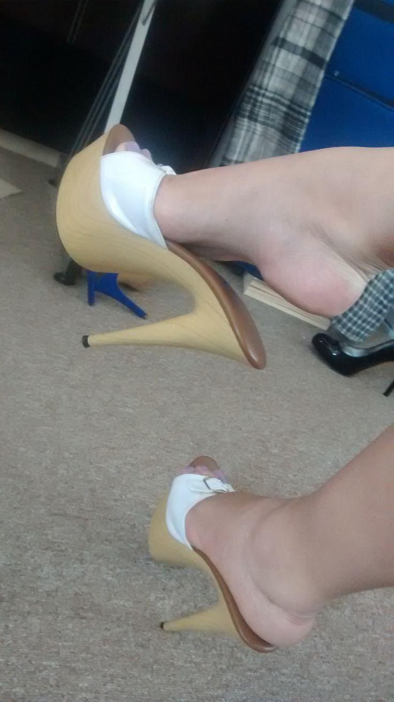 wife posing in clogs