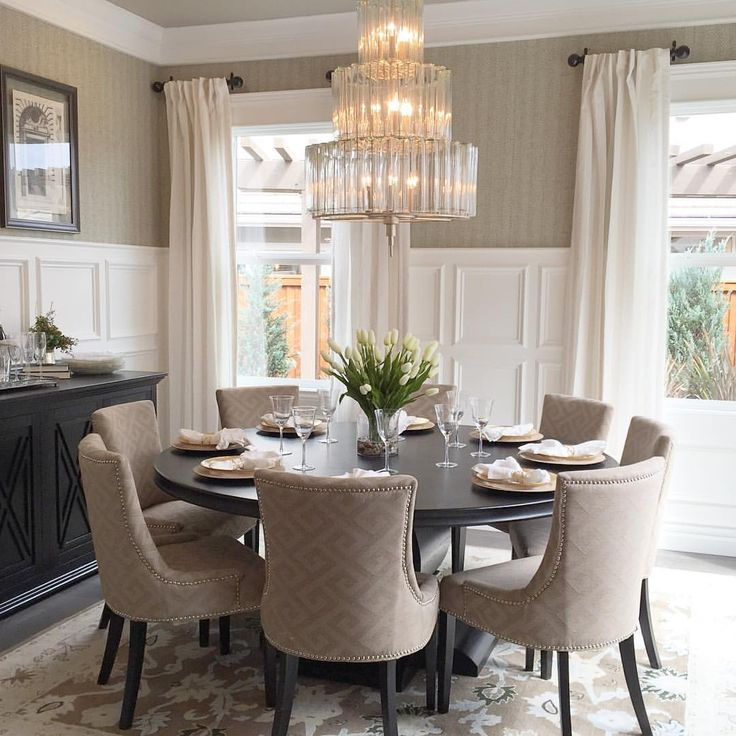 25 best ideas about round dining tables on pinterest for Model home dining room