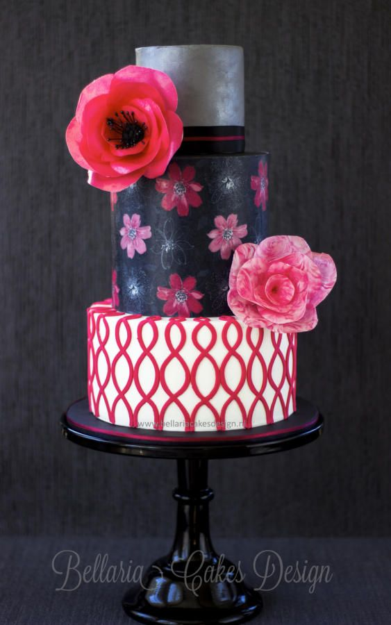 Sweet sixteen birthday cake with bright pink wafer paper flowers
