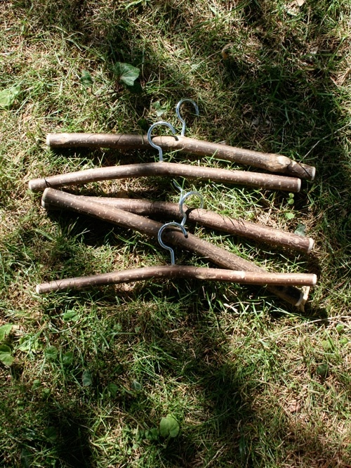 CINTRE EN NOISETIER wooden hangers - k this pic has inspired me. hooks srewed into branches for doll hangers