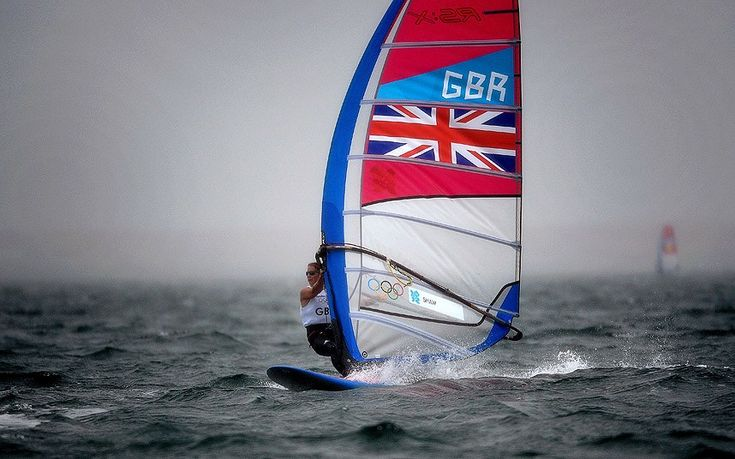 Great Britain's Bryony Shaw sails through the rain in the women's RS:X sailing class