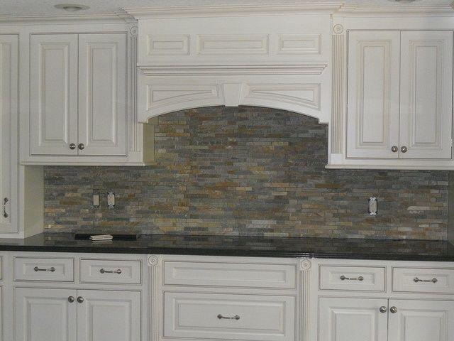 Best 25 stacked stone backsplash ideas on pinterest for White kitchen cabinets with stone backsplash