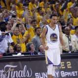 Golden State Warriors' Stephen Curry celebrates a Cleveland Cavaliers' turnover during overtime of the Warriors' 108-100 win in Game 1 of the 2015 NBA Finals at Oracle Arena in Oakland, Calif., on Thursday, June 4, 2015.