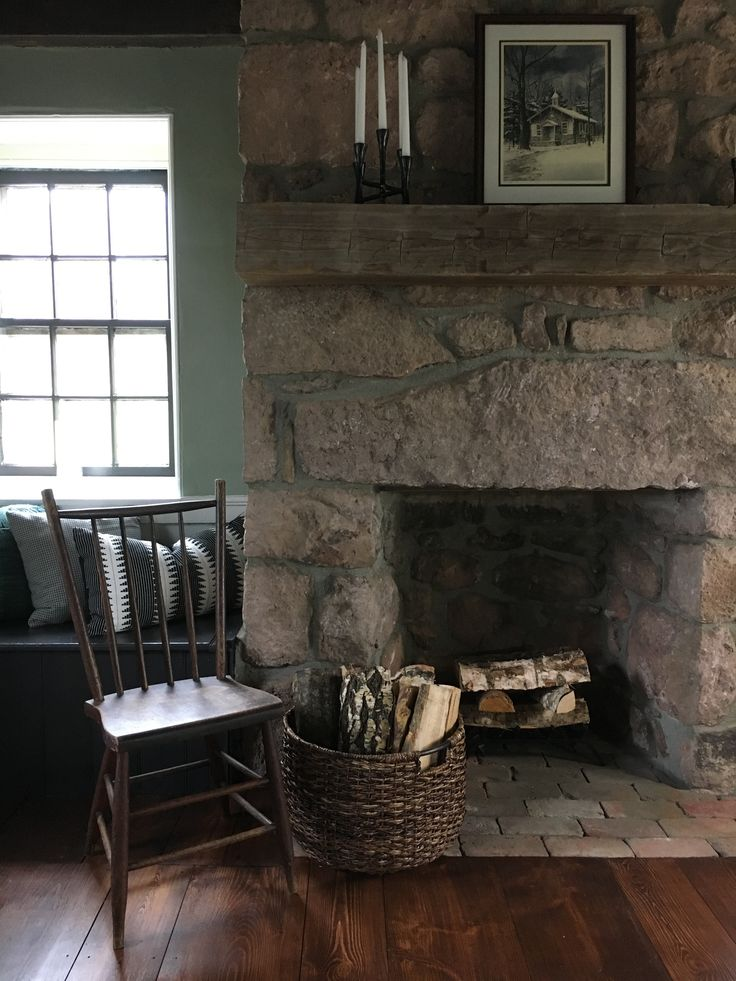 Exposed stone fireplace and a primitive side chair.  Stone House Revival - Season One.