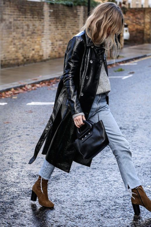Photos via: Fashion Me Now Lucy made a bold move in this edgy yet casual combo. Instead of the standard camel-colored tie-waist trench coat, she opted for a black PU trench coat. The coat speaks for i