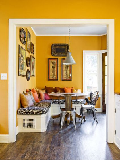 Mediterranean Kitchen by Lori Smyth DesignSaffron and spice. Deep goldenrod yellow is an upbeat, spirited hue. The spicy tone of deep yellow works well with other spice-inspired hues, so try it with cushions in cinnamon, curry, mustard seed and clove. Walls painted saffron also make a wonderful base color for arrangements of artwork; finish your breakfast nook with framed artwork and objects hung gallery style.