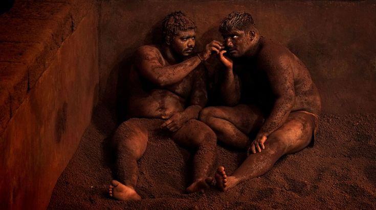 "Kushti, Indian Wrestling: ""At the end of a workout, wrestlers rest with their heads against the arena. Photo: Alain Schroeder - National Geographic Traveler Photo Contest"
