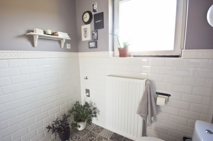 Small grey bathroom with white metro and pathwork tiles. Hemnes furnitures from IKEA.