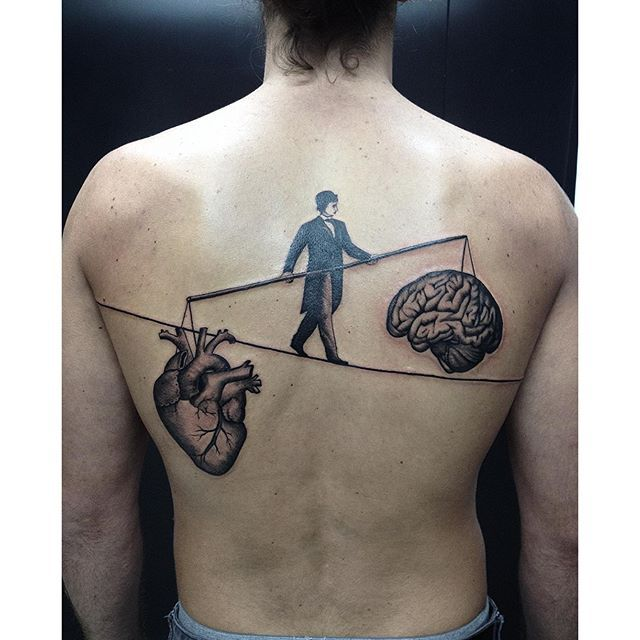 Eduardo Reis - Surreal Line work Tattoo representative of the fight or balance between heart and mind