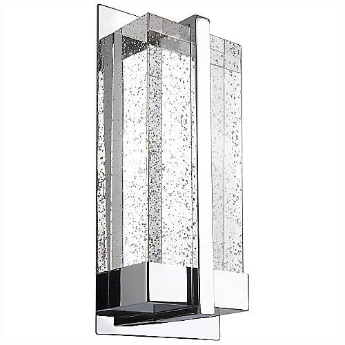The Kuzco Lighting WS2812 LED Wall Sconce showcases an intriguing block of crystal encased in a heavy-gauged steel frame. The crystal sits directly above the LED board, allowing the illumination to fully distribute through the translucent material, as well as give the bubbles inside a beautiful shine.