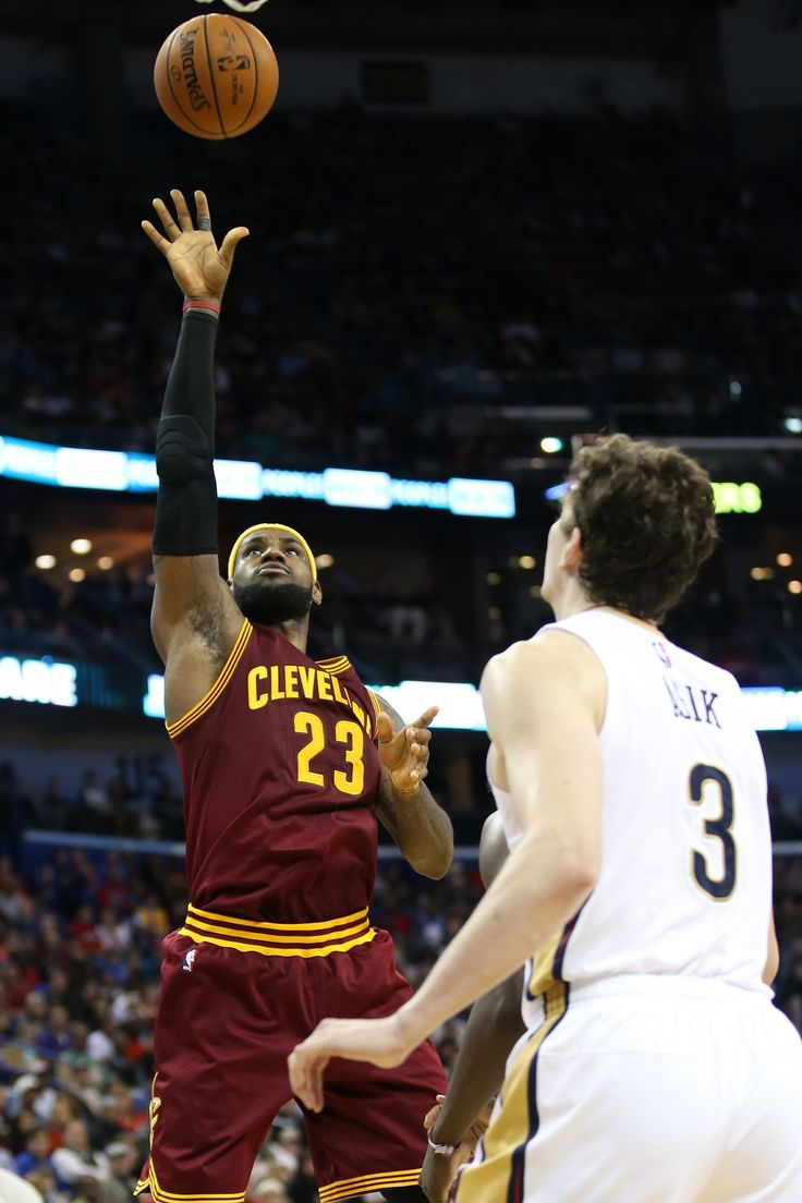 LeBron James #23 of the Cleveland Cavaliers shoots the ball over Omer Asik #3 of the New Orleans Pelicans at Smoothie King Center on December 12, 2014 in New Orleans, Louisiana.