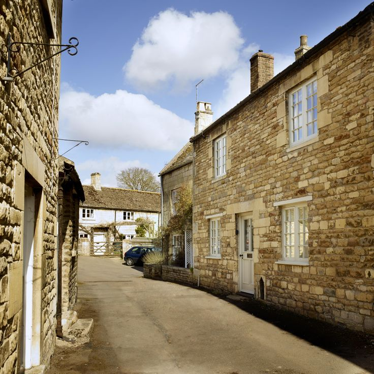 Chapel Lane on a bright Spring day, with our 18th century holiday cottage on the right-hand side.