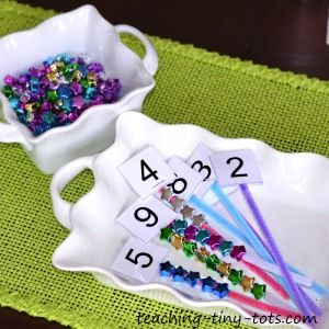 Learning and Reinforcing Numbers with Beads and Pipecleaners in a Hands On Activity.  Great for Math Centers.