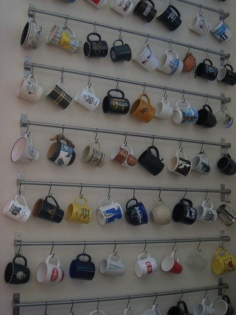 Displaying mugs using a kitchen rail and hooks from Ikea. @Erica Cerulo Cerulo Cerulo Broten why do I imagine your house having this?