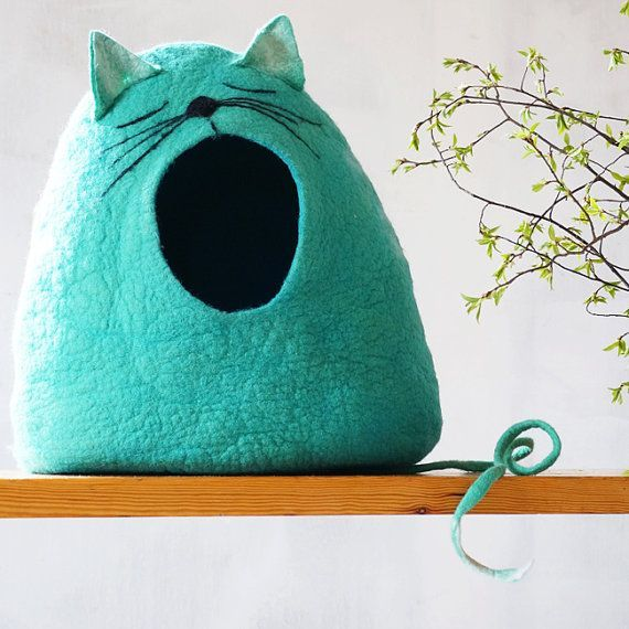 100 % natural wool and handmade felt cat bed. I make cat caves from soft organic wool. Felting pet house I used only soap and water. In this cat house pet will feel safe and cat cave has a tail which will serve as pet toy. SIZE (in photo XL size): S: Deep: approximately 28 cm