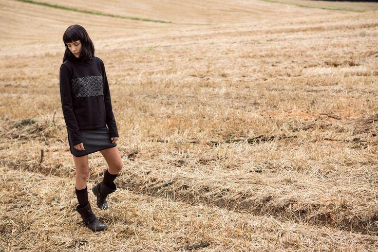 Black hoodie, sweatshirt & sporty mini skirt. Kamila Gronner FW 2014/15 collection. http://kamilagronner.shwrm.com/ona/odziez/bluzy/48274_kamila-gronner-bluza-czarno-biala-p.html