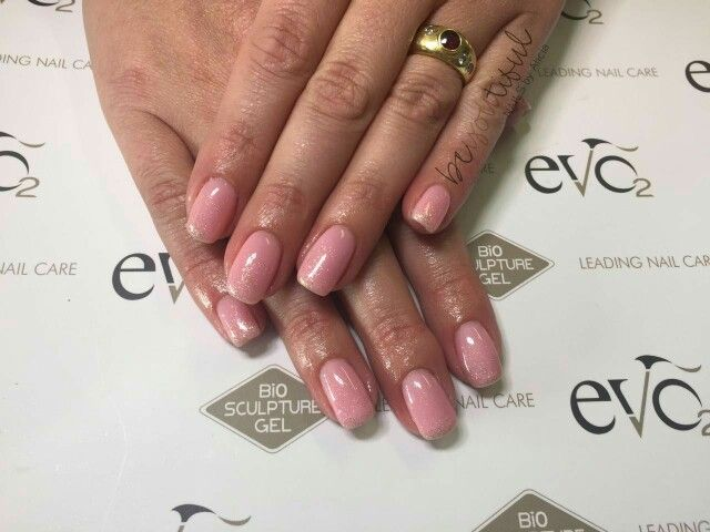 EVO Gel by Bio Sculpture Gel  Angela and Crystal.   Light pink, soft look, gold glitter faded.
