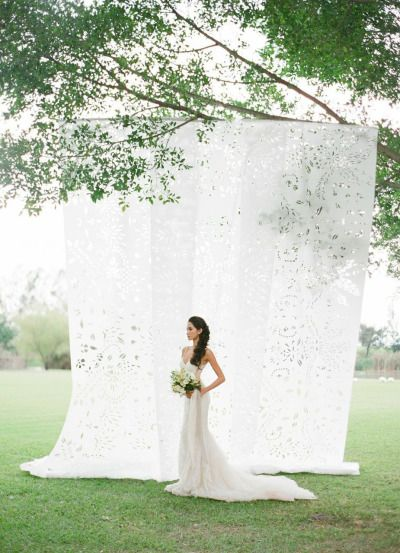 Papel Picado backdrop: http://www.stylemepretty.com/2015/06/19/papel-picado-wedding-backdrop/ | Photography: Jose Villa - http://josevillablog.com/
